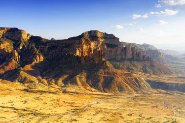CLKRM132918 Sunset lit Gheralta Mountains and Abuna Yemata Guh rock hewn church, aerial view, Hawzen, Tigray Region, Ethiopia, Africa
