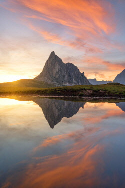CLKCC132356 the Ra Gusela mountain reflected in small puddle of water at sunset, Giau Pass, Dolomiti, municipality of Cortina d'Ampezzo, Veneto district, Italy, Europe