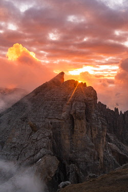 CLKGM130874 Cimon del Latemar peak from Schenon mount during a summer sunset. Costalunga pass, Fassa valley, Pozza di Fassa, Trento district, Dolomites, Italy, Europe.