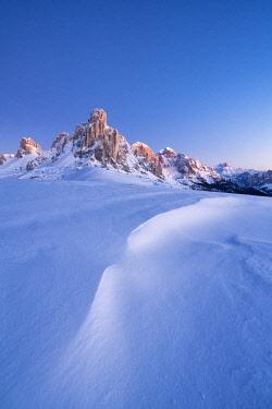 CLKRM126765 Dusk lights on Ra Gusela mountain and snowy slopes, Giau Pass, Dolomites, Belluno province, Veneto, Italy