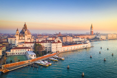 CLKST129760 Aerial view of Punta della Dogana, Santa Maria della Salute church and St Mark square at sunrise. Venice, Veneto, Italy.