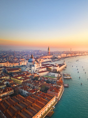 CLKST129764 Aerial view of Punta della Dogana, Santa Maria della Salute church and St Mark square at sunrise. Venice, Veneto, Italy.