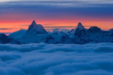 CLKGM132015 Matterhorn peak over a clouy carpet during a winter sunrise. Igloo refuge des Pantalons Blancs, Heremence, Sion, Valais,  Switzerland