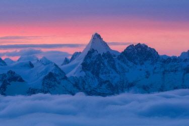 CLKGM132016 Matterhorn peak over a clouy carpet during a winter sunrise. Igloo refuge des Pantalons Blancs, Heremence, Sion, Valais,  Switzerland