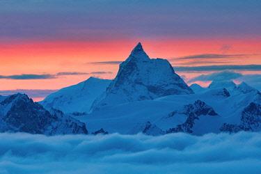 CLKGM132017 Matterhorn peak over a clouy carpet during a winter sunrise. Igloo refuge des Pantalons Blancs, Heremence, Sion, Valais,  Switzerland