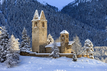 CLKRG127406 Church of San Gian surrounded by snowy woods, Celerina, Engadine, canton of Graubunden, Switzerland