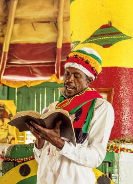 JAM0203AW Rasta Man reading Bible, Weekly Sabbath Celebration, School of Vision Temple, Rastafarian Community, Blue Mountains, Saint Andrew Parish, Jamaica
