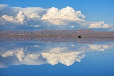 BOL8780AW South America, Andes, Altiplano, Bolivia, Salar de Uyuni. car on playa