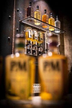 FRA11862AW France, Corse, Aleria, Bottles of whiskey in the tasting room of the Avela factory.
