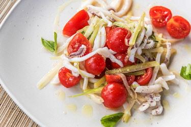 ITA15580AW europe, Italy, Tuscany, Elba Island, tomato and squid salad