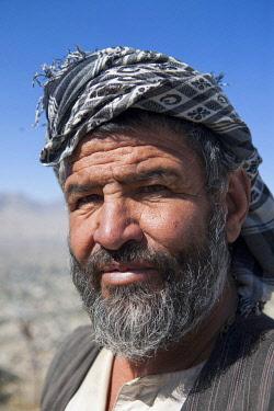 AFG0009AW A bearded man wearing a headscarf, Kabul, Afghanistan