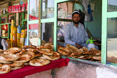 AFG0019AW A baker sits in his shop selling flat bread, Kabul, Afghanistan