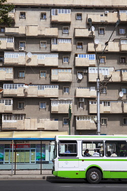 TAJ1139AW A bus stands at a bus stop in front of an apartment buildling in Dushanbe, Tajikistan