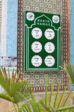 TAJ1141AW Prayer times sign at a mosque, Dushanbe, Tajikistan