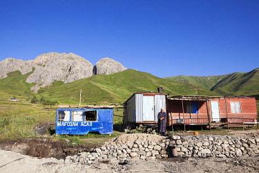 TAJ1148AW A Tajik woman stands outside her home on the Pamir Highway; Tajikistan