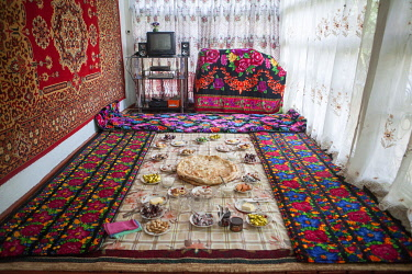 TAJ1150AW Lunch laid out on a tablecloth on the floor, at a homestay on the Pamir Highway, Tajikistan
