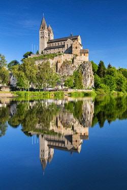 IBLAVI05804491 Church of St. Lubentius in Dietkirchen an der Lahn, reflection in the river Lahn, near Limburg an der Lahn, Hesse, Germany, Europe