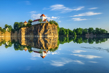 IBLAVI05804498 Kirchberg with mountain church and water tower, reflection in the water of the quarry lake, Beucha, Brandis, near Leipzig, Saxony, Germany, Europe