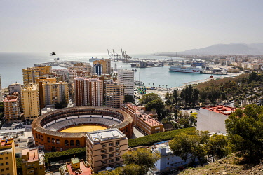 Bullfighting arena and the new harbour district with promenade Muelle Uno, Malaga, Andalusia, Spain, Europe