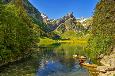 IBLSHU05783058 Rowing boats on the Seealpsee, behind the Santis, Alpstein, Canton Appenzell, Switzerland, Europe