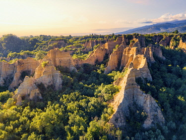 ITA15665AWRF Balze del Valdarno, eroded rock formations near Florence, Tuscany, Italy. Sunset view