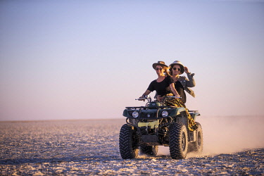 Women riding a quad bike, Makgadikgadi Salt Pans, Botswana