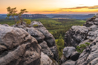 GER12390AW Germany, Saxony. A landscape at sunset in the Saxon Switzerland with rock formations