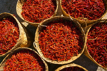 MYA2916AWRF Top view of red chili peppers in wicker baskets, near Kalaw, Kalaw Township, Taunggyi District, Shan State, Myanmar
