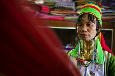 MYA2654AW Portrait of Kayan woman sewing, Lake Inle, Nyaungshwe Township, Taunggyi District, Shan State, Myanmar