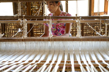 MYA2661AW Burmese woman working with weaving loom, Lake Inle, Nyaungshwe Township, Taunggyi District, Shan State, Myanmar