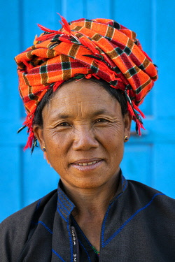 MYA2779AW Woman from Pa-O tribe wearing traditional orange headwear, village near Kalaw, Kalaw Township, Taunggyi District, Shan State, Myanmar