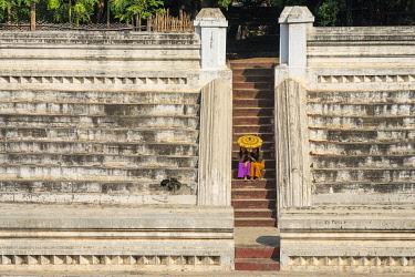 MYA2871AW Two young women sitting at stairs at Khan Taw Mingalar, Mandalay, Mandalay Region, Myanmar