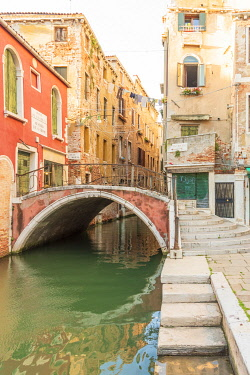 ITA15686AW Europe, Italy, Venice. One of the typical venetian channels and a brigde