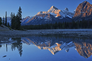 CN01BJY0266 Canada, Alberta, Jasper National Park. Mountains reflected in river at sunrise.