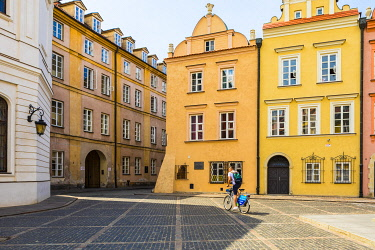 POL2543AW Cyclist in Old Town, Warsaw, Poland, Europe