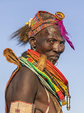 SUD1349 Africa; South Sudan; Kapoeta. A portrait of an old Toposa lady in traditional attire.
