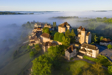 FRA11982AW Curemonte labelled l'un des plus beaux villages de France (most beautiful villages in France) viewed from the air on a misty morning, Correze, Nouvelle-Aquitaine, France, Europe