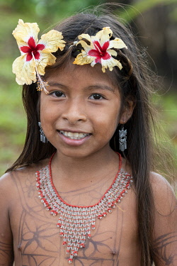 SA15CMI0442 Central America, Panama, Gatun Lake. Embera Indian village. Young Embera girl with flowers in her hair.
