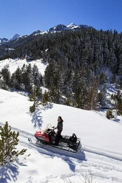 SPA10029AW Europe, Spain, Catalonia, Val d'Aran, Snowmobile in the Aiguamog valley.