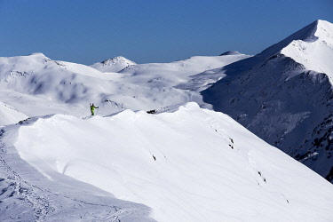SPA10040AW Europe, Spain, Catalonia, Val d'Aran, A skier approaching a off-piste slope in Baqueira ski station.