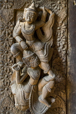 Detail of carved out character on wooden walls of Shwe In Bin monastery, Mandalay, Mandalay Region, Myanmar
