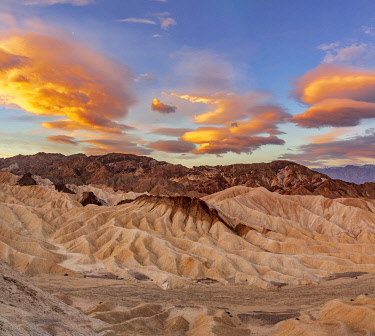 US05CHA0547 Dramatic sunrise clouds over Zabriskie Point at sunrise in Death Valley National Park, California, USA.