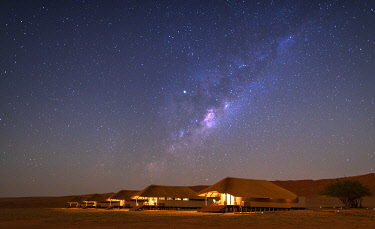 NAM6779 Namibia, NamibRand Nature Reserve, Kwessi Dunes, the guest chalets beneath the stunning night sky.
