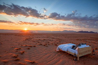 NAM6782 Namibia, NamibRand Nature Reserve, Kwessi Dunes, a luxurious bed in the desert.
