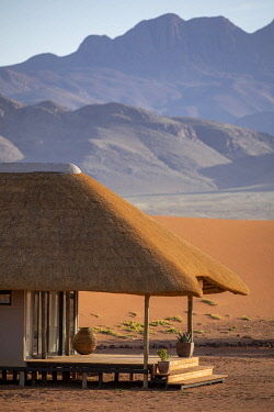 NAM6789 Namibia, NamibRand Nature Reserve, Kwessi Dunes, a guest chalet with mountain backdrop.