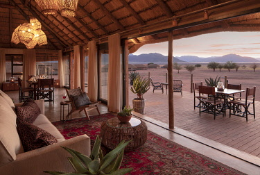 NAM6793 Namibia, NamibRand Nature Reserve, Kwessi Dunes, mess interior with views across the desert to the mountains.