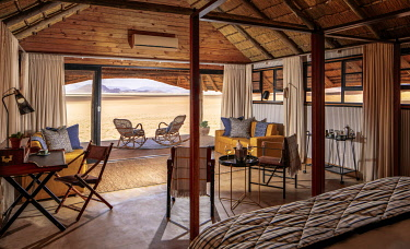 NAM6800 Namibia, NamibRand Nature Reserve, Kwessi Dunes, interior of a guest chalet with breathtaking views beyond.