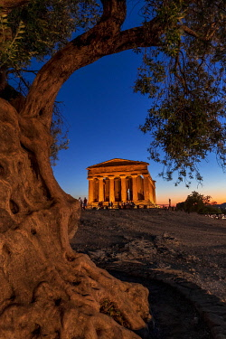 ITA15826AW Agrigento, Sicily. People visiting Concordia Temple in the Valley of Temples at dusk