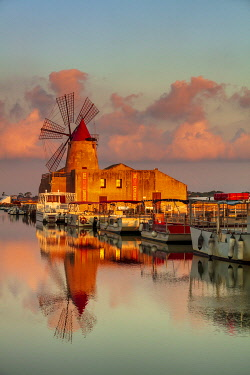ITA15949AW Marsala, Sicily. Windmills reflecting at sunrise in the saltern between Marsala and Trapani