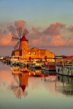 ITA15949AW Marsala, Sicily. Windmills reflecting at sunrise in the saltern between Marsala and Trapani